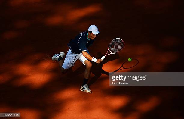Go Soeda of Japan plays a backhand during his match against Andy Roddick of USA during day five of Power Horse World Team Cup at Rochusclub on May 24...