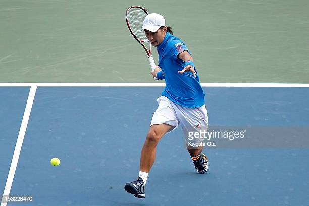 Go Soeda of Japan plays a forehand in his first round match against Kei Nishikori of Japan during day two of the Rakuten Open at Ariake Colosseum on...