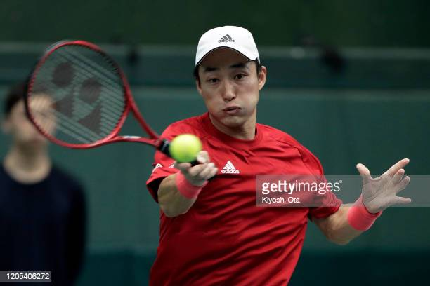 Go Soeda of Japan plays a forehand in his singles match against Emilio Gomez of Ecuador on day one of the Davis Cup qualifier between Japan and...