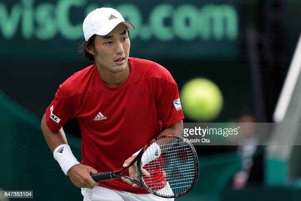 Go Soeda of Japan plays in his singles match against Thiago Monteiro of Brazil during day one of the Davis Cup World Group Play-off between Japan and...