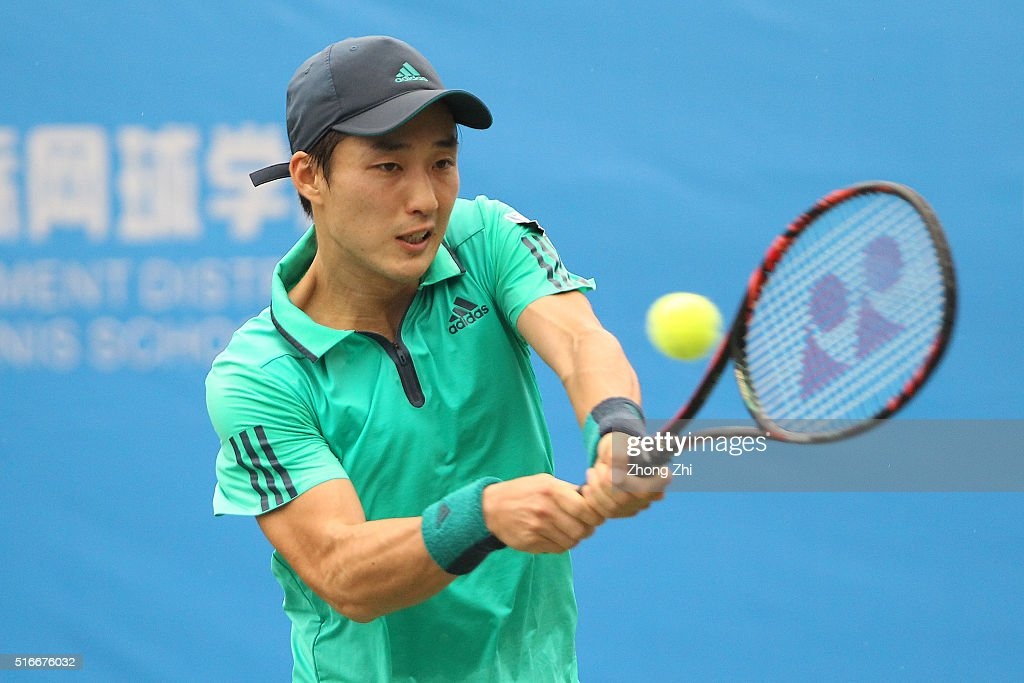 Go Soeda of Japan returns a shot during the match against Dudi Sela of Israel during the 2016 ÒGDD CUPÓ International ATP Challenger Guangzhou Tour Day 6 match at Guangzhou Development District International Tennis School on March 20, 2016 in Guangzhou, China.