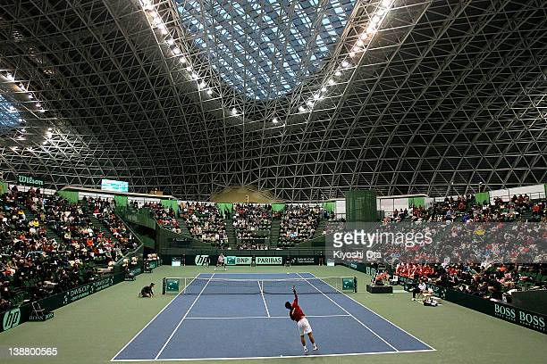 Go Soeda of Japan serves in his singles match against Ivo Karlovic of Croatia during day three of the Davis Cup World Group 1st Round match between...