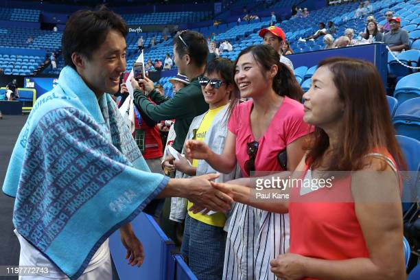 Go Soeda of Team Japan greets fans after winning his singles match against Aleksandre Metreveli of Team Georgia during day four of the 2019 ATP Cup...