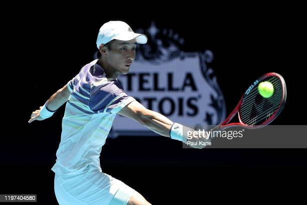 Go Soeda of Team Japan plays a backhand to Martin Cuevas of Team Uruguay during day two of the 2020 ATP Cup Group Stage at RAC Arena on January 04,...