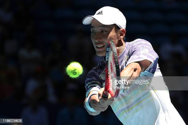 Go Soeda of Team Japan plays a backhand to Roberto Bautista Agut of Team Spain during day six of the 2020 ATP Cup Group Stage at RAC Arena on January...