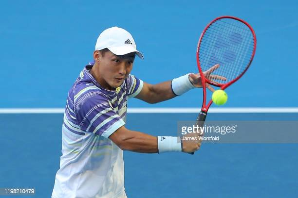 Go Soeda of Team Japan plays a volley during the doubles match during day six of the 2020 ATP Cup Group Stage at RAC Arena on January 08 2020 in...