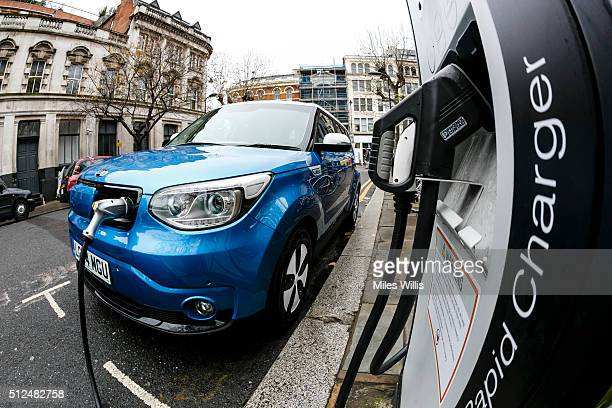 Go Ultra Low Kia Soul EV on charge on a London street Ultralow emission vehicles such as this can cost as little as 2p per mile to run and some...