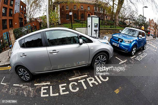 Go Ultra Low Nissan LEAF and Kia Soul EV on charge on a London street Ultralow emission vehicles such as this can cost as little as 2p per mile to...
