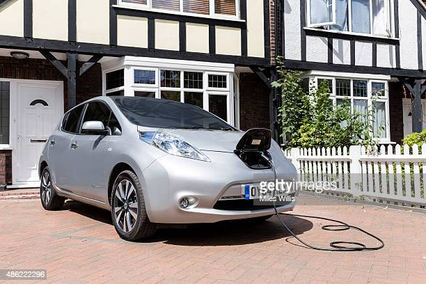 Go Ultra Low Nissan LEAF on charge on a London driveway on July 21 2015 in London England Ultralow emission vehicles such as this can cost as little...
