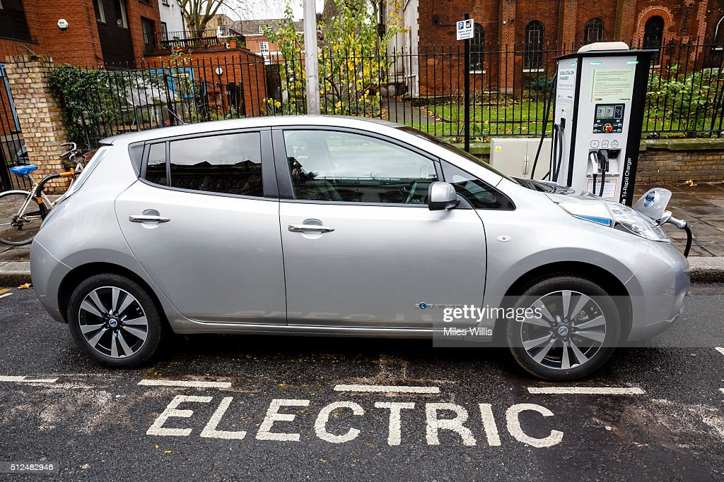 Go Ultra Low Nissan LEAF On Charge On A London Street. Ultra Low Emission