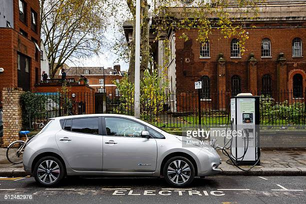 Go Ultra Low Nissan LEAF on charge on a London street Ultralow emission vehicles such as this can cost as little as 2p per mile to run and some...
