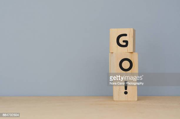 go! word on wooden blocks - single word stock pictures, royalty-free photos & images