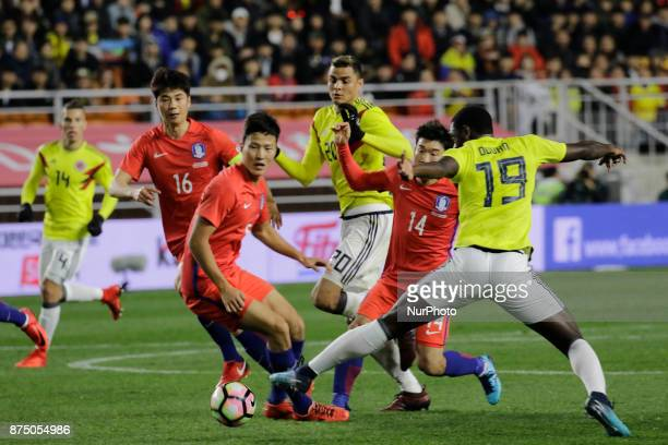 Go Yo Han of South Korea and Duvan Zapata of Colombia in action during an KEB HANA BANK Invitational Friendly Match South Korea v Colombia at Suwon...