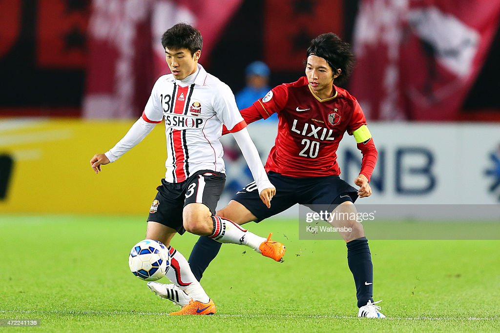 Go Yohan #13 of FC Seoul and Gaku Shibasaki #20 of Kashima Antlers compete for the ball during the AFC Champions League Group H match between Kashima Antlers and FC Seoul at Kashima Stadium on May 5, 2015 in Kashima, Japan.