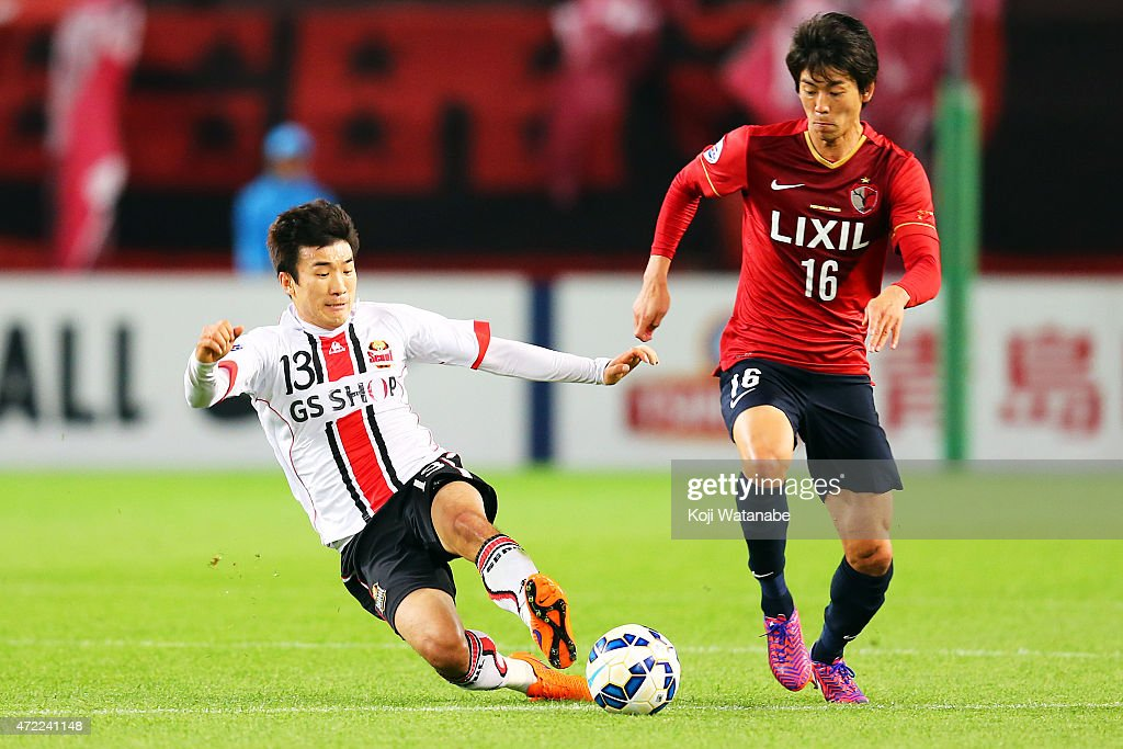 Go Yohan #13 of FC Seoul and Shuto Yamamoto #16 of Kashima Antlers compete for the ball during the AFC Champions League Group H match between Kashima Antlers and FC Seoul at Kashima Stadium on May 5, 2015 in Kashima, Japan.