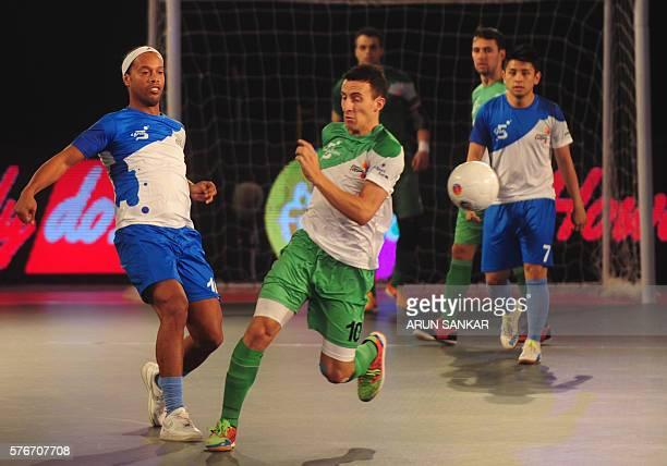 Goa 5's Ronaldhinio plays against Bengaluru 5's Maxi during their Premier Futsal Football League match in Chennai on July 17 2016 / AFP / ARUN SANKAR