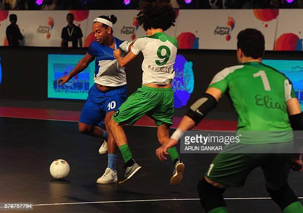 Goa 5's Ronaldhinio plays against Bengaluru 5's Nabil during their Premier Futsal Football League match in Chennai on July 17 2016 / AFP / ARUN SANKAR