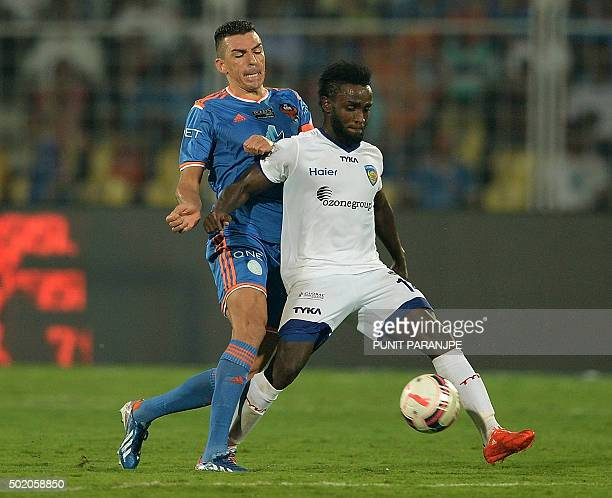 FC Goa player Lucio and Chennaiyin FC player John Stiven Mendoza Valencia struggle for the ball during the final match between Chennaiyin FC and FC...