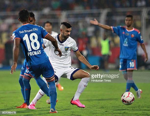 Goa player Pronay Halder vying for ball with Chennaiyin FC player Jayesh Rane during ISL Final match at Jawaharlal Nehru Stadium on December 20 2015...