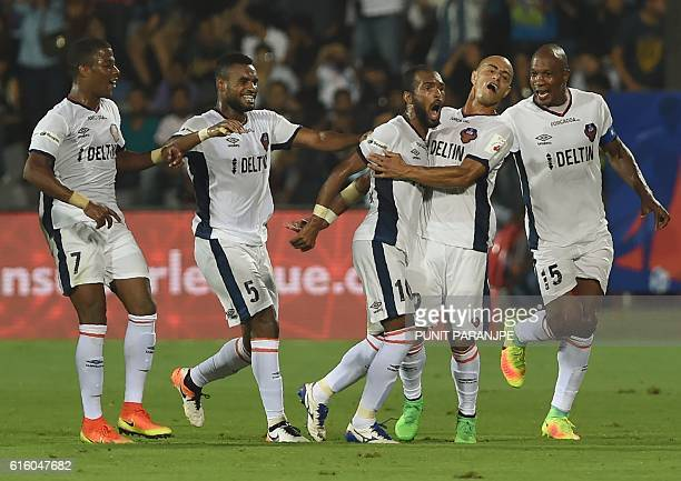 FC Goa players celebrate after scoring a goal during the Indian Super League football match between FC Goa and Mumbai City FC at The Mumbai Football...