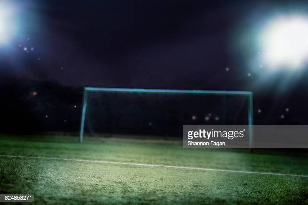 Goal in sports field at night
