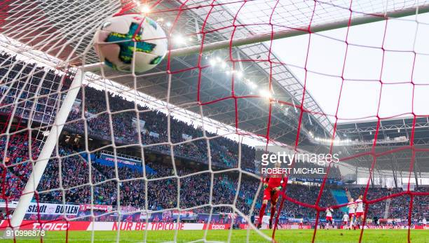 A goal is pictured as Leipzig´s Hungarian goalkeeper Peter Gulacsi reacts during the German first division Bundesliga football match between RB...