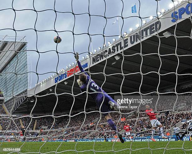 Goal keeper Anders Lindegaard of Manchester United makes a flying save during the Barclays Premier League match between Newcastle United and...