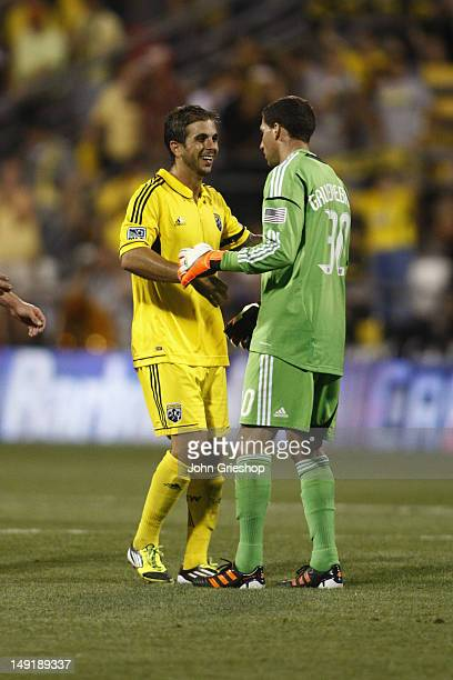 Goal Keeper Andy Gruenebaum and Carlos Mendes of the Columbus Crew celebrate a victory during the game against the DC United at Columbus Crew Stadium...