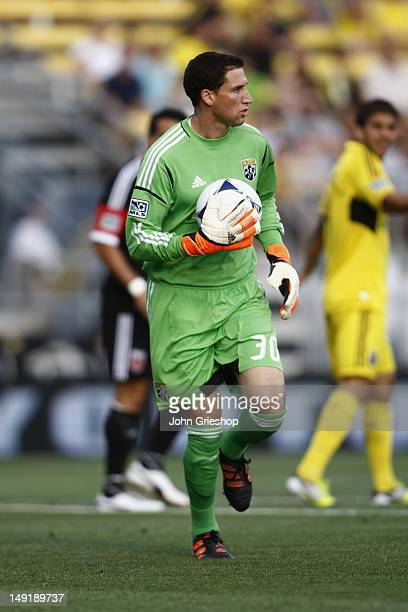 Goal Keeper Andy Gruenebaum of the Columbus Crew controls the ball during the game against the DC United at Columbus Crew Stadium on July 21 2012 in...