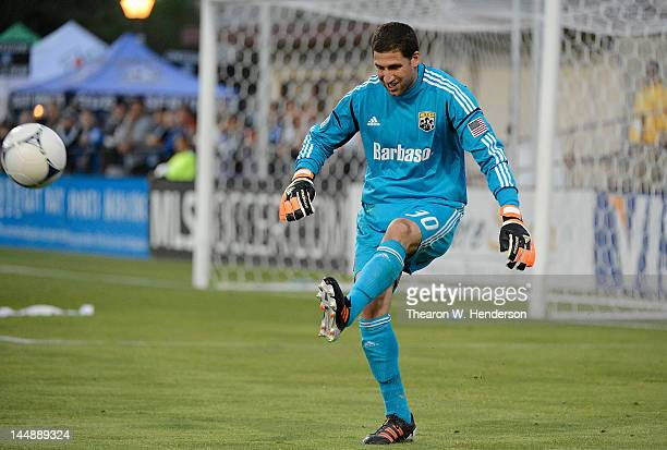 Goal Keeper Andy Gruenebaum of the Columbus Crew kicks the ball up field away from his goal against the San Jose Earthquakes in the first half at...