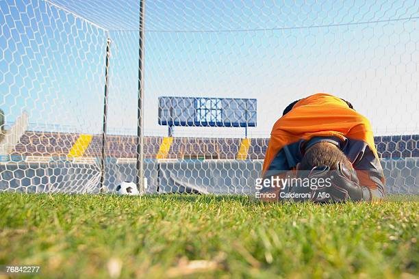 goal keeper broken down in guilt - goalkeeper stock pictures, royalty-free photos & images