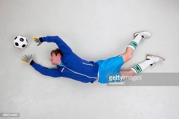 Goal keeper catching football