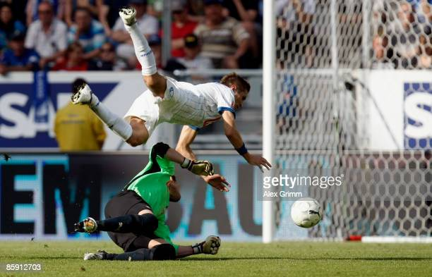 Goal keeper Daniel Haas of Hoffenheim tackles Stanislav Sestak of Bochum before being sent off with a red card during the Bundesliga match between...