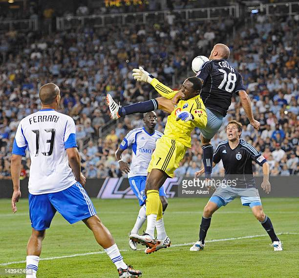 Goal keeper Donovan Ricketts of the Montreal Impact saves a shot on goal against defender Aurelien Collin of Sporting Kansas City during the second...