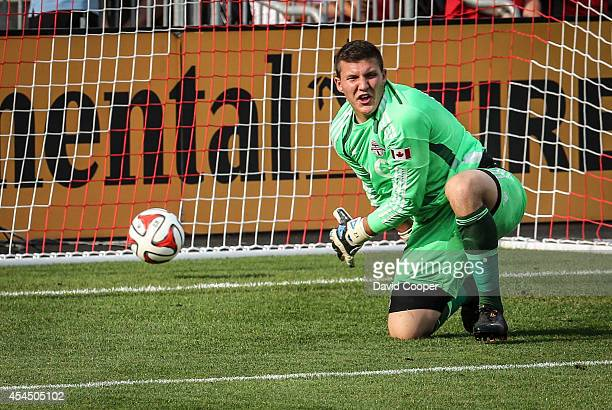 Goal Keeper Joseph Bendik of TFC berates his defence after Kelyn Rowe scored the 2nd goal for the Revolution during the game between Toronto FC and...