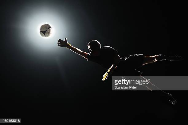 goal keeper jumping to the ball - goalie goalkeeper football soccer keeper stock pictures, royalty-free photos & images