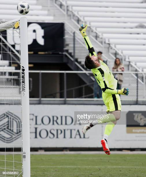 Goal keeper Liam Kelly of Scottish club Rangers FC tips a second half scoring attempt over the goal post against Brazilian club Corinthians during...