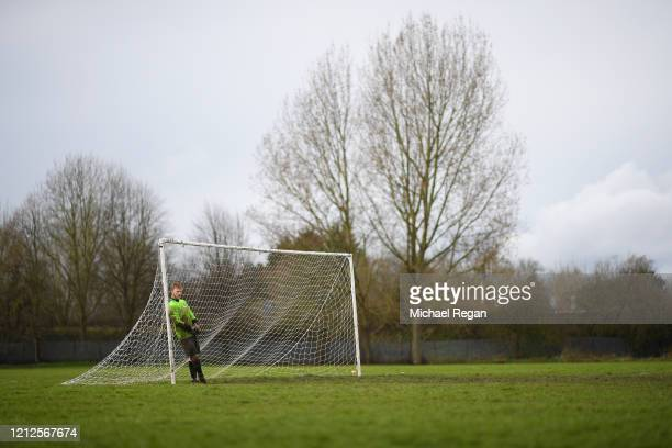A goal keeper looks on during Sunday league football between Syston Brookside FC and Shepshed Oaks FC on March 15 2020 in Leicester England