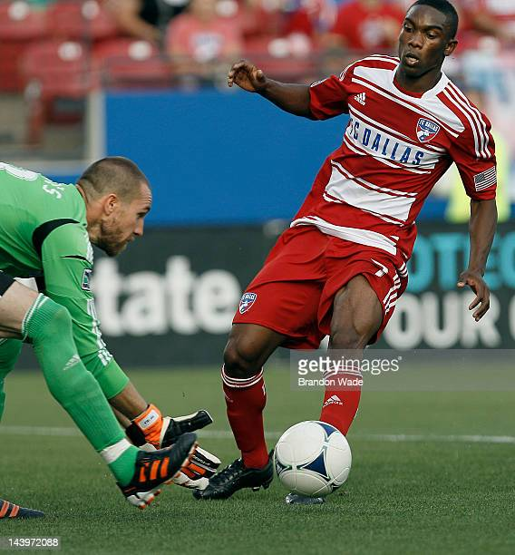 Goal keeper Matt Pickens of the Colorado Rapids collects the ball as Fabian Castillo of the FC Dallas closes in during the first half of a soccer...
