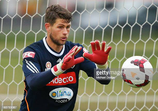Goal keeper Nathan Coe stops a ball during a Melbourne Victory ALeague training session at Gosch's Paddock on October 10 2013 in Melbourne Australia