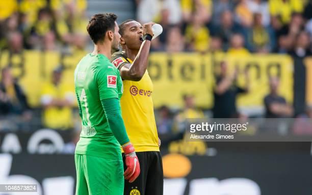 Goal keeper Roman Buerki and Manuel Akanji of Borussia Dortmund in action during the Bundesliga match between Borussia Dortmund and FC Augsburg at...
