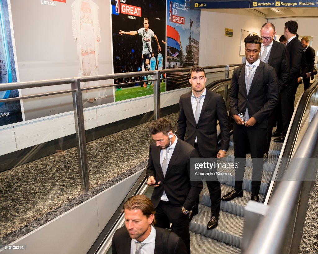Goal keeper Roman Buerki, Sokratis Papastathopoulos and Dan-Axel Zagadou of Borussia Dortmund after landing in London for the UEFA Champions League: First Qualifying Round 1st Leg match between Tottenham Hotspur and Borussia Dortmund at London Airport on September 12, 2017 in London, England.