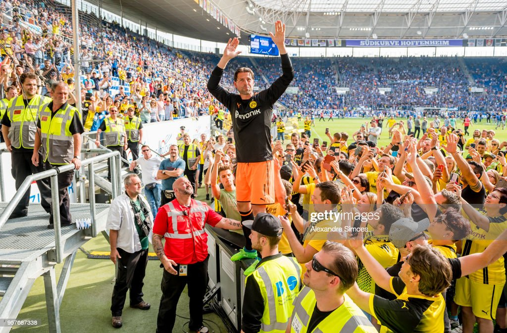 Goal keeper Roman Weidenfeller of Borussia Dortmund together with the fans after his last match for the club after the final whistle the Bundesliga match between TSG 1899 Hoffenheim and Borussia Dortmund at the Wirsol Rhein-Neckar-Arena on May 12, 2018 in Sinsheim, Germany.