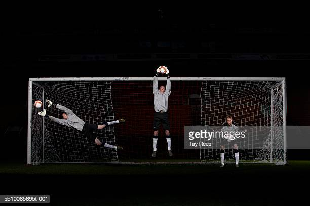 goal keeper saving goal - making a save sports stock pictures, royalty-free photos & images