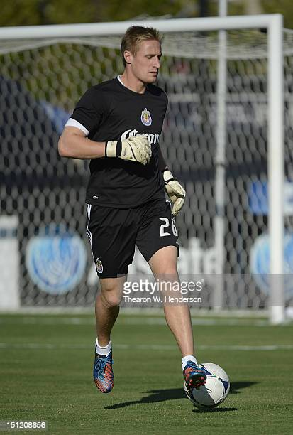 Goal Keeper Tim Melia of Chivas USA warms up in pregame warm ups before an MLS soccer game against the San Jose Earthquakes at Buck Shaw Stadium on...