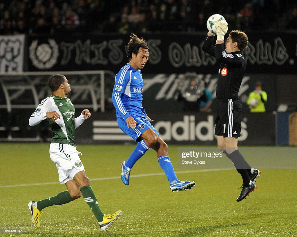 Goal keeper Troy Perkins #1 of Montreal Impact grabs the ball as Ryan Johnson #9 of Portland Timbers and Alessandro Nesta #14 of Montreal Impact close in during the second half of the game at Jeld-Wen Field on March 09, 2013 in Portland, Oregon. Montreal won the game 2-1.