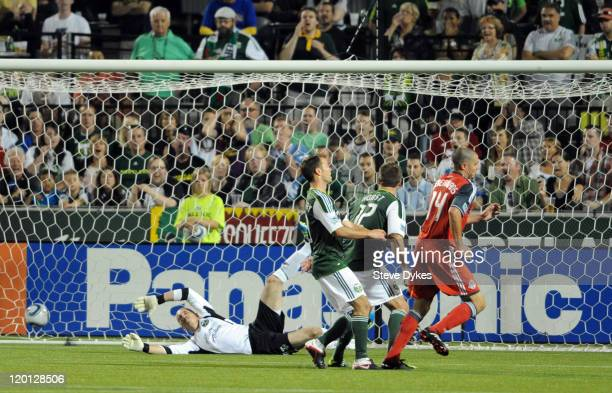Goal keeper Troy Perkins of the Portland Timbers dives in vain for the shot and goal by Danny Koevermans of Toronto FC during the second half of the...