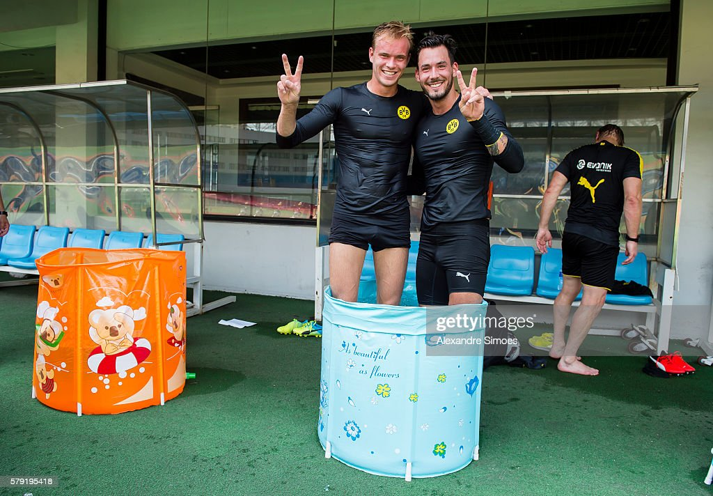 Goal keepers Roman Buerki and Hendrik Bonmann of Borussia Dortmund are cooling down after a training session during Borussia Dortmund's Summer Asia Tour 2016 on July 23 2016 in Shanghai, China.