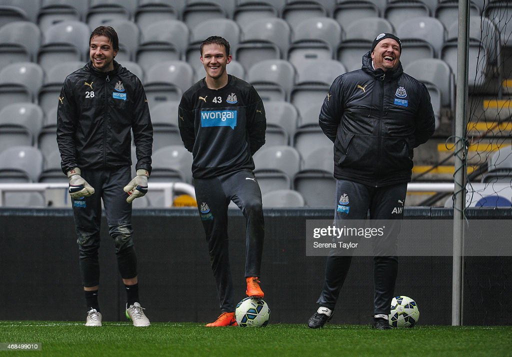 Goal Keepers Tim Krul (L) and Freddie Woodman (C) laugh with Goal Keeping Coach Andy Woodman (R) during a Newcastle United Training session at St.James' Park on April 3, 2015, in Newcastle upon Tyne, England.