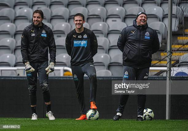 Goal Keepers Tim Krul and Freddie Woodman laugh with Goal Keeping Coach Andy Woodman during a Newcastle United Training session at StJames' Park on...
